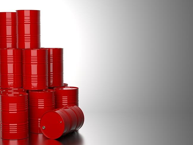 Bunch of Red Barrels for Oil on Gray Background. 3D Render.