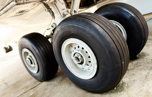 Airplane nose landing gear locked resulting in emergency landing